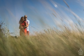 Golf du Morbihan, France environmental engagement e-session in the tall grass field, shot from a low angle