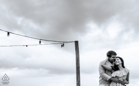Maceió, Alagoas on-location portrait e-shoot created as a man hugs his bride-to-be on a rooftop