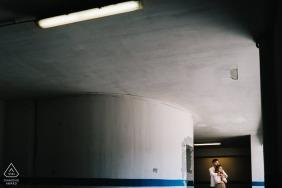 True Love Engagement Portrait Session in Naples showing a couple in an urban concrete parking structure