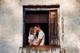 True Love pre wedding Photoshoot at Pantano de El Jándula of a Jaén framed in the building window opening