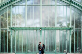True Love Engagement Posed Portrait at Les Serres d'Auteuil in Paris capturing a Couple embracing in front of the greenhouses