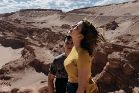 True Love Engagement Portrait Session in Atacama Desert displaying a couple enjoying the sun and wind in the dunes
