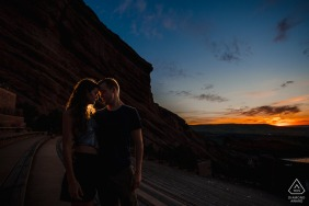 True Love Engagement Portrait Session at Red Rocks Amphitheater in Morrison displaying how a couple snuggles in together during sunrise