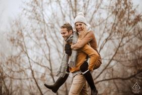 True Love Pre-Wedding Portrait Session at the Vila Ekaterina in Bulgaria illustrating a Happy couple going piggyback