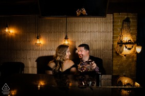 True Love Engagement Picture Session in Sidecar New Braunfels showing a couple having drinks in the low light of the restaurant bar