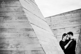 True Love Engagement Posed Portrait in Dolni Vestonice capturing a BW Architectural couple