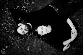 True Love pre wedding Photoshoot in Pavlov of a High contrast couple lying on their backs in all black