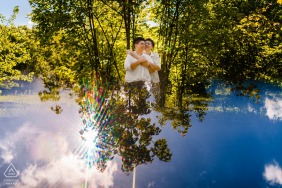 True Love pre wedding Photoshoot at Bosco Romagno, Cividale of a couple with a Sky reflection and smiles