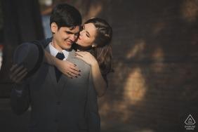 Petrópolis, RJ couple e-session with a cheek kiss in the warm sunlight