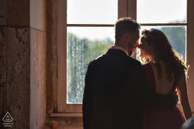 São Jose das Três Ilhas couple e-session in Minas Gerais while touching noses indoors by the window light
