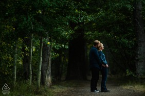 Galena Forest, Nevada couple e-session standing in the trees facing the light