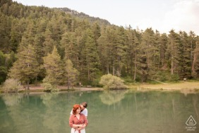 France couple e-session at Lac Saint Apollinaire with hugs by the lake at the edge of the tree forest