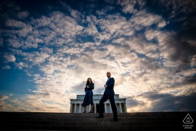 Lincoln Memorial DC couple e-session, Shot from a low angle, the couple stands on the steps