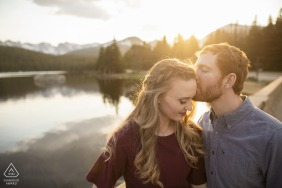 Brainard Lake, Colorado couple e-session along the bridge near the lake as the sun was just setting behind the mountains in the Indian Peaks Wilderness in Boulder County