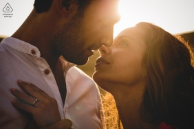 Val D'orcia couple e-shoot in Tuscany for a color sunset close up photo of the couple