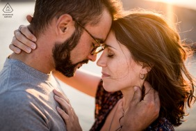 Marseille, France couple e-session with intimate embrace in the sunset sunlight