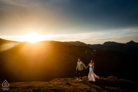 Keystone, CO couple e-shoot some some active Running to light at sunset