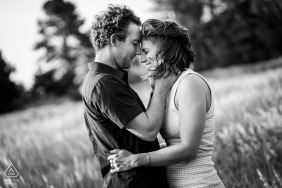 Denver couple shares a moment during their engagement session at Blackmer Lake