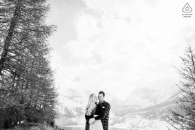 French Alps bride and groom to be, posturing for an engagement image in front of the Alps