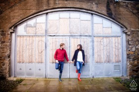 Nantes bride and groom to be, posturing for an engagement image while holding hands before the arched doorway