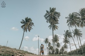 Maceio bride and groom to be, modeling for a pre-wedding picture for some AL love among coconut trees