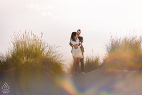 Montpellier bride and groom to be, posing for a pre-wedding engagement photo shoot at the sand dunes with dune grasses