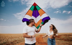 Amambai  bride and groom to be, playing for a pre-wedding engagement photo shoot while exuding happiness running and flying kites