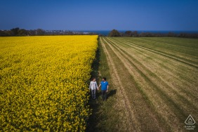 Saint Cast bride and groom to be, posing for a France pre-wedding engagement photo shoot in fields