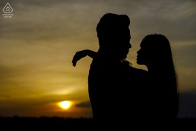 Cappadocia bride and groom to be, posing for a Turkey pre-wedding engagement photo shoot at sunset with a yellow silhouette