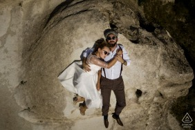 Turkey bride and groom to be, relaxing for a Cappadocia pre-wedding engagement session lying down on the rocks