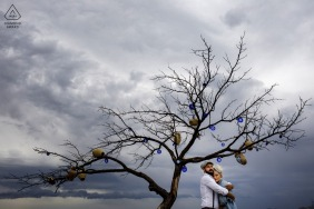 Cappadocia bride and groom to be, embracing under a tree for a Turkey engagement image