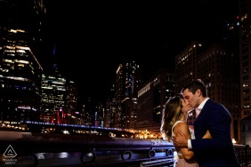 Chicago bride and groom to be, posturing for an engagement image with a nighttime shoot on the La Salle St bridge using the streetlight behind me to light them, along with a flash behind them for rim light
