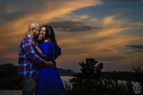 Horsetooth Reservoir, Fort Collins, Colorado outside environmental prewedding photoshootwith a Couple enjoying a moment in the sunset