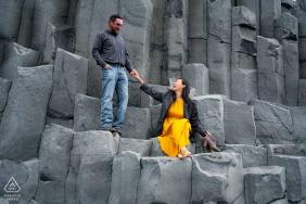 Iceland outside environmental couple prewedding photo shootat the rock quarry in an orange dress