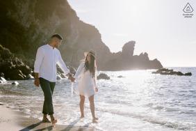 Tropea, italy environmental couple pre wedding image sessionwhile walking along the sea shore