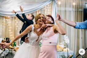 Happy bride and her mother dancing at a Kustendil, Bulgaria wedding venue
