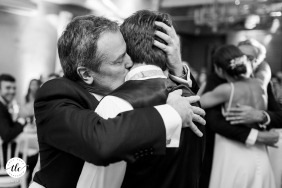 Provence wedding reception hug between father and son