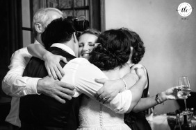 Cantacuzino Castle Busteni wedding pictures of a group hug between bride, sister, and parents