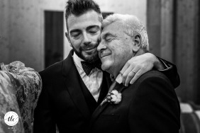 La Subida Restaurant, Gorizia, Italy wedding reception image of a father and son's expressing love for one another
