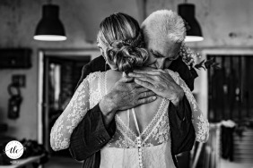 A dad hugging his daughter on her wedding day in Arette, France