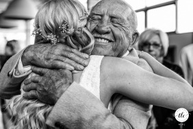 Enjoy Centre, St. Albert wedding day photo of the Grandpa hugging the bride