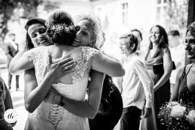 wedding image from Vrtba garden of a big group hug