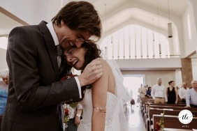 At the end of the ceremony, the bride got very emotional and started crying in the groom's arms at a Church in Ansião, Pombal, Portugal