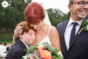 Maysville, Georgia documentary wedding image of a mom hugging her son after ceremony