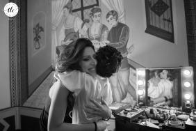 Castello di Valenzano - Arezzo - Italy wedding reportage image of a big hug between bride and her make-up artist