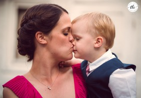 Sofia wedding reportage image of the godmother kissing her son during the wedding party