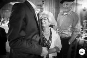 Chamonix Mont Blanc France wedding reportage image of a grandma and the groom holding each other