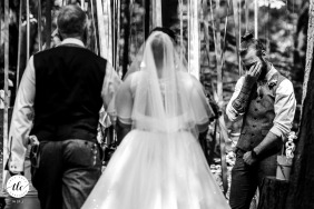 Camp Katur, North Yorkshire, wedding reportage image of the groom as he sees his bride for the first time during the ceremony and he breaks down - a beautiful moment