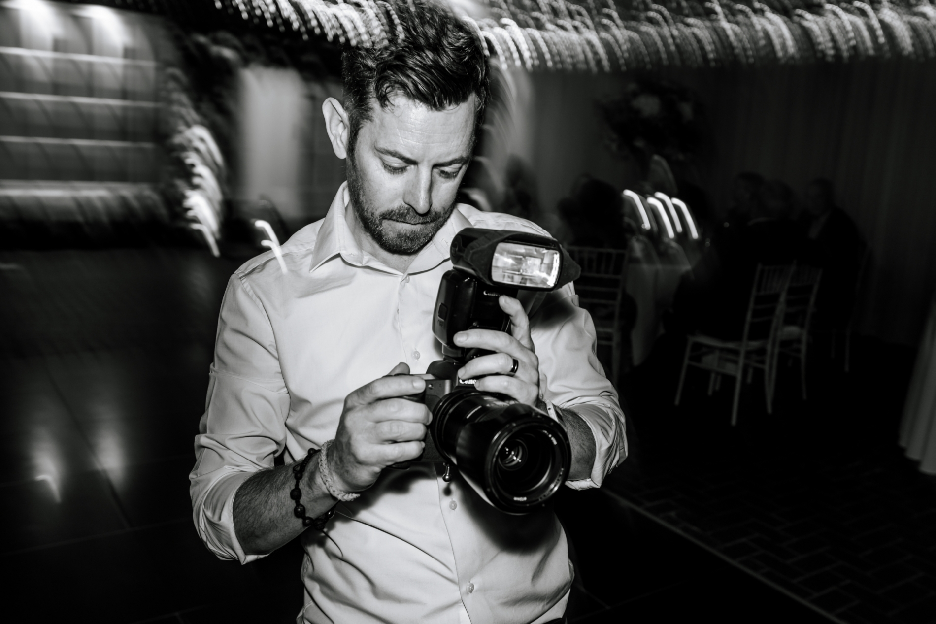 Liverpool Wedding Photographer working at the reception party - Black and white photo