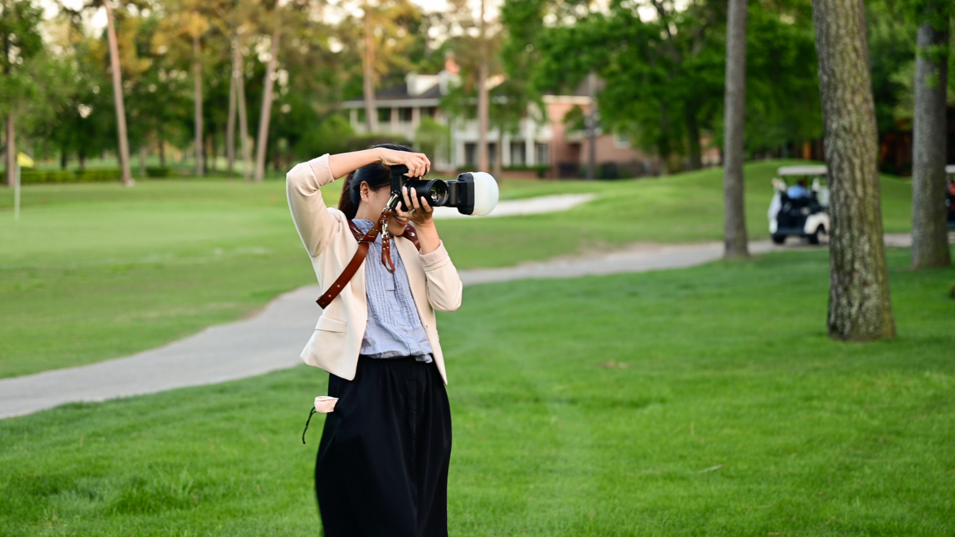 Image of a working wedding photographer at a Houston, Texas outdoor venue event
